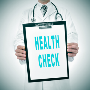 A doctor showing a clipboard with health check written in it