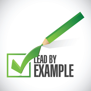 Green lead by example check mark and pencil