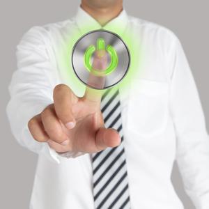 Businessman touching a power button