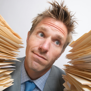 Manager choosing between two stacks of project files