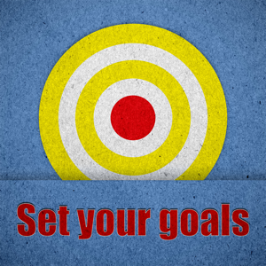 Set your goals written on blue paper