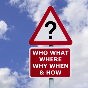 Signpost saying who, what, where, why, when and how